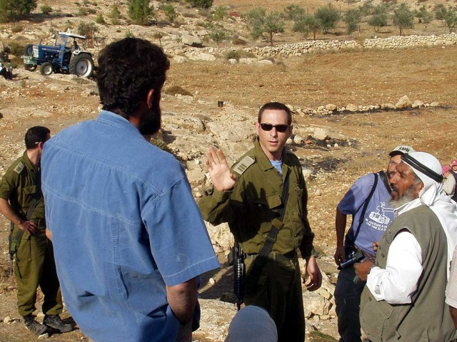 IDF soldiers with Palestinian villagers