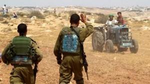IDF soldaten en Palestijnse boeren