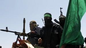 Strijders van de Al-Qassam brigades van Hamas bij de begrafenis van een mede-strijder, juni 2014