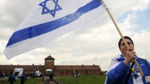 """An Israeli young woman waves the Israeli flag as she participates with hundreds of other Israeli youth in """"the March of the Living"""" tour which involves visiting concentration and death camps in Poland. May 02, 2011. (photo credit: Yossi Zeliger/Flash90)"""