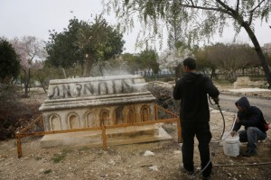 """Jerusalem municipality workers clean anti-muslim graffitti reading """"Muhammed Dead"""" which was spray-painted on muslim graves at a cemetery in the Independence Park in Jerusalem. February 14, 2013. Photo by Miriam Alster/FLASH90"""