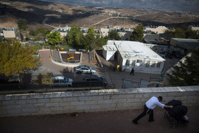 An ultra-Orthodox Jewish man in the neighborhood of Ramat Shlomo, where about 500 new apartments received an Israeli committee's approval on Monday. Credit Uriel Sinai for The New York Times